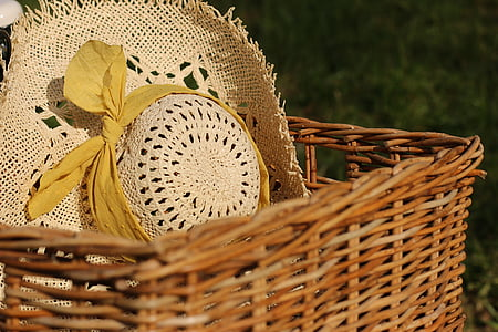 brown hat on brown wicker basket