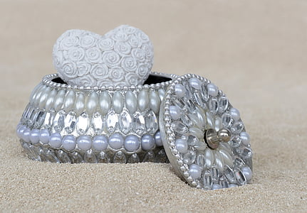 silver-colored clear gemstone encrusted jewelry box