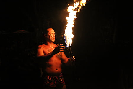 man holding torch with fire