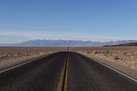 landscape photography of gray concrete road
