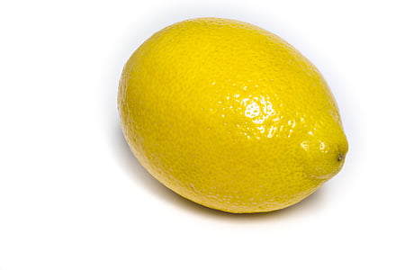 ripe lemon fruit on white surface