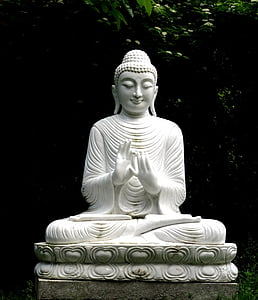 white ceramic buddha figurine