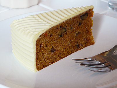 slice cake on plate with silver forks
