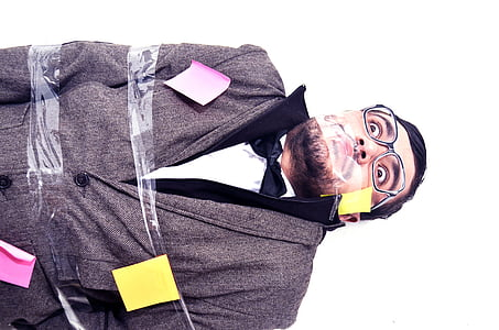 man covered with adhesive tape and sticky notes