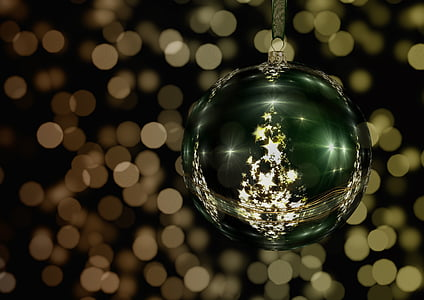 green and gold bauble with bokeh background