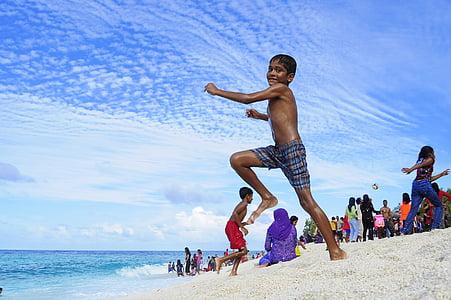 boy wearing black shorts jumping