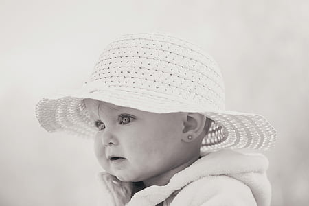 grayscale photo of baby wearing white knitted hat