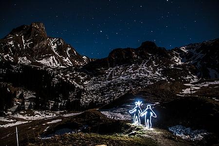 two human neon figures on mountain alps