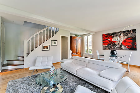 white couch and glass-top center table