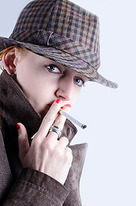 person holding cigarette