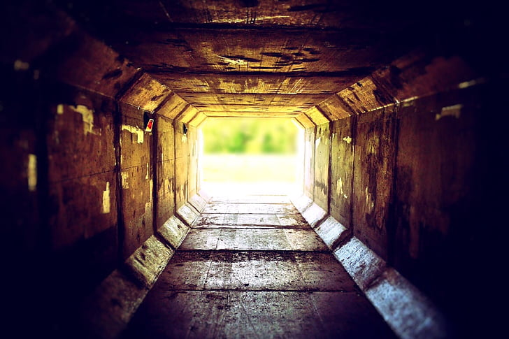 brown tunnel leading outside