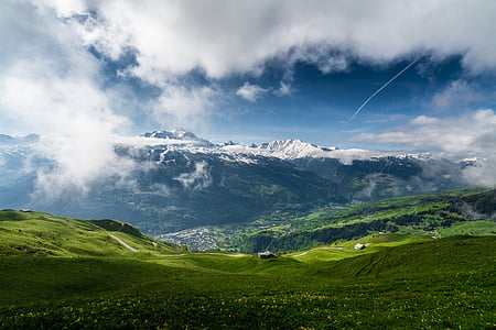 landscape photo of a green mountain peak under cloudy sky