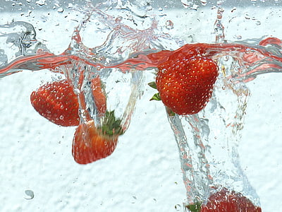 strawberry fruits dipped on water