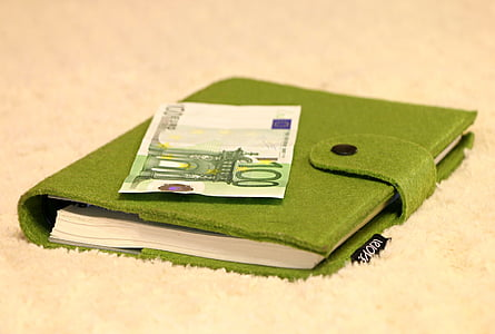 100 Euro banknote on green notebook