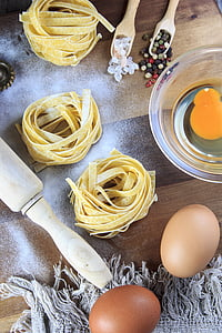yellow noodles with eggs nearby