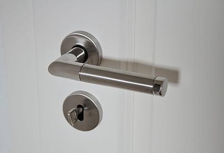 silver door handle and deadbolt with key