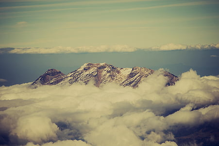 aerial photography of snow mountain surrounded by clouds