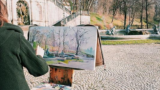 woman in black hoodie top painting