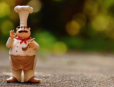 photography of selective focus male chef figurine