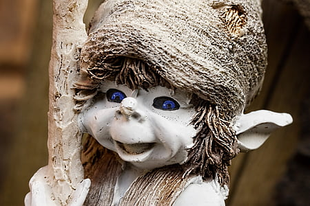 close-up photography of white elf statue