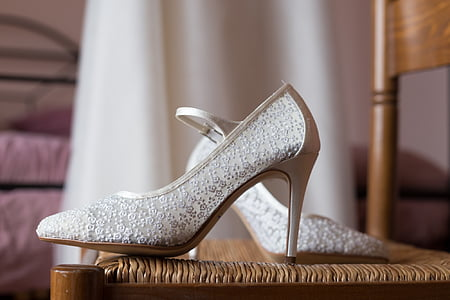 pair of women's white pumps