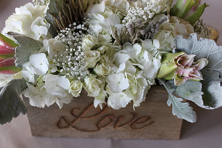 assorted-color flower decor on brown wooden box