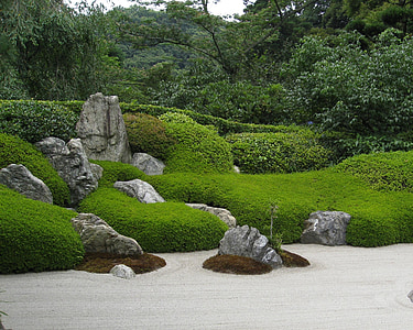 green grasses and rock formations