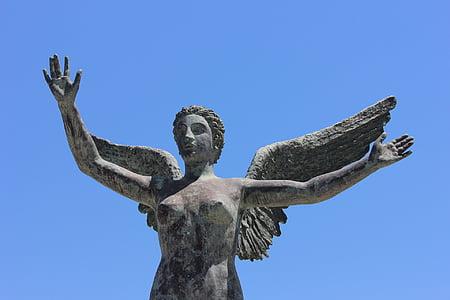 closeup photo of female angel statue