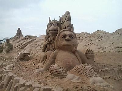 sand sculpture of horned monster