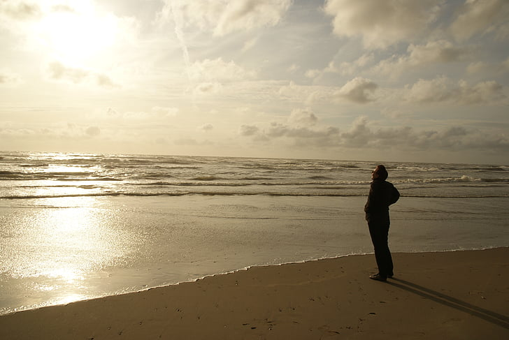man standing in the shore