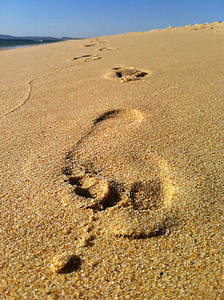 close-up photo of footprint on sand