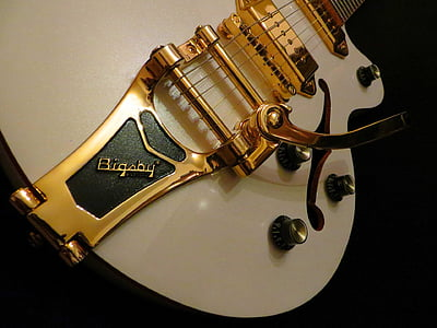 gold and white guitar