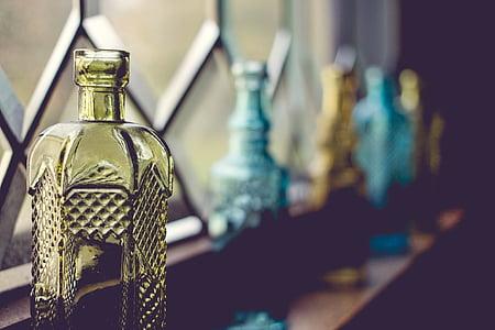 macro shot of yellow glass bottle