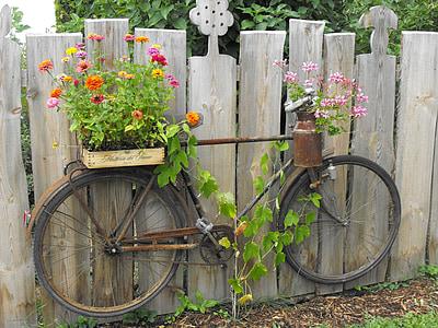 two flower pots on brown bike pot rack