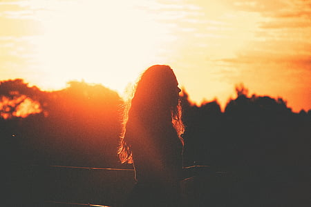 silhouette photo of woman during sunset