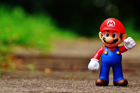 tilt-shift photo of Mario figurine