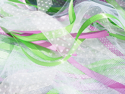 white, pink, and white textiles