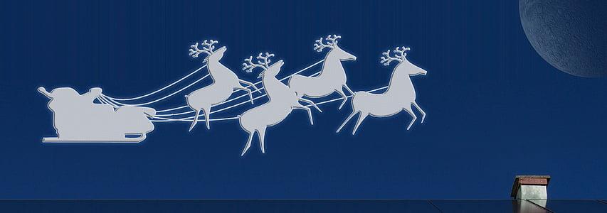 Santa Claus sleigh and deer wallpaper