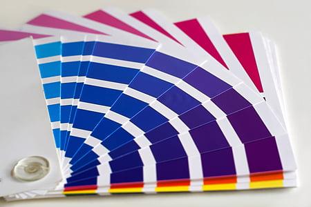 purple and white paper fan