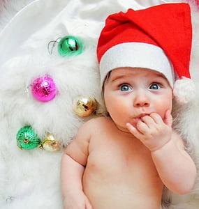 closeup photo of baby wearing Santa hat