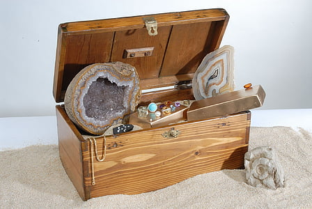 brown and gray geode stone inside brown wooden chest box