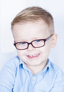 boy wearing eyeglasses with red frames