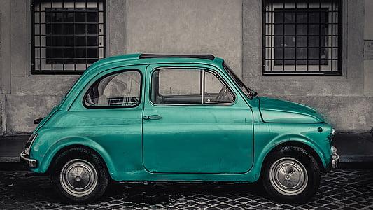 green 3-door hatchback parked on roadside