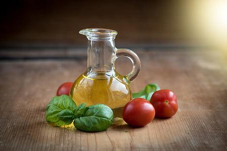 oil in vial near tomatoes