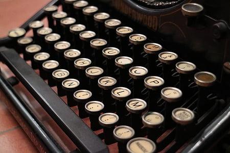 closeup photo black and white typewriter