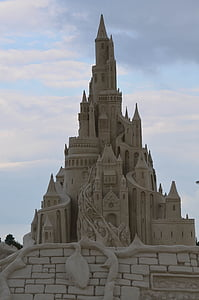 brown sand castle under cloudy sky during daytime