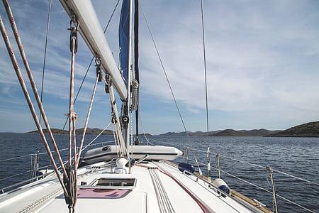 white motor boat at daytime