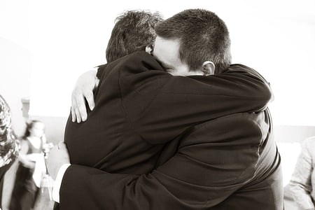 men wearing suit hugging