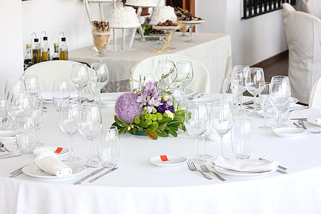 fine dining dinnerware set on white tablecloth covered table