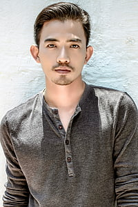 man wearing grey Henley button shirt